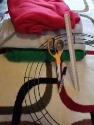 Crafting supplies - a wreath frame, scissors, ruler, stack of felt, marker.