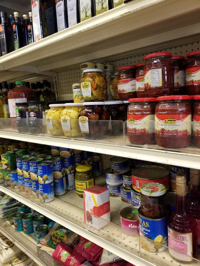 image of a shelf with various condiments.